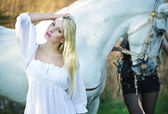 White angel and the horse in the background — Stock Photo