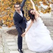 Laughing wedding couple in funny pose — Stock Photo #37675681