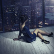 Art photo of girl in apartment in skyscraper — Stock Photo #38930667