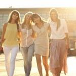Four joyful girlfriends on the walk — Stock Photo