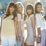 Four beautiful ladies in casual pose — Stock Photo