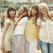 Cheerful ladies in the middle of the square — Stock Photo