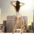 Sexy woman on the terrace in the skyscraper — Stock Photo #38934971