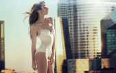 Sensual brunette lady in the skyscraper — Stock Photo
