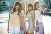 Four beautiful ladies in casual pose — Stock Photo