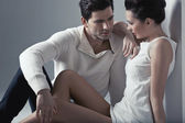 Handsome man touching soft skin of woman — Stock Photo