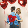 Fall in love among lots of balloons — Stock Photo