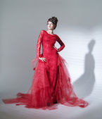 Proud red queen in fashion pose — Stock Photo