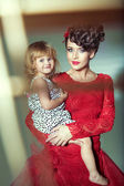 Beautiful woman with her joyful daughter — Stock Photo