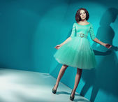 Candy girl wearing bright green dress — Stock Photo