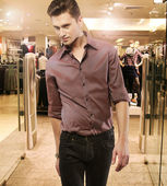 Young man in the boutique — Stock Photo