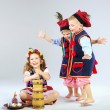 Three little friends wearing traditional costumes — Stock Photo
