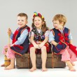 Stock Photo: Joyful children wearing national costumes