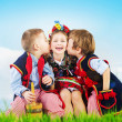 Three cheerful kids wearing national costumes — Stock Photo