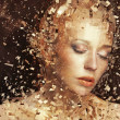 Stock Photo: Art photo of golden womsplintering to thousands elements