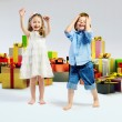 Stock Photo: Happy kids with lots of gifts