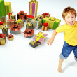 Amazed little boy with lots of presents — Stock Photo