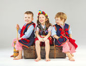 Joyful children wearing national costumes — Stock Photo