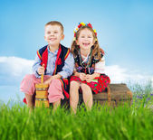 Little couple wearing national costumes — Stock Photo