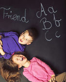 Cute kids playing on the black board — Stock Photo