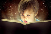 Little boy and the magic book — Stock Photo