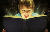 Small boy carrying a magic book — Stock Photo