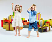 Happy kids with lots of gifts — Stock Photo