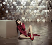 Conceptual photo of woman in the golden room — Stock Photo