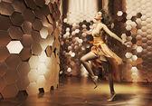 Dancing young woman wearing fabulous dress — Stock Photo