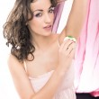 Young beautiful brunette shaving her armpit — Stock Photo #4288086