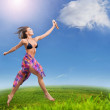 Young beautiful woman sprays clouds on a sunny day — Stock Photo #4293117