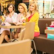 Three attractive women in the shopping mall — Stock Photo