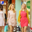 Three attractive girls walking around the shopping mall — Stock Photo #43265977