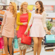 Group of girlfriends at the shopping — Stock Photo