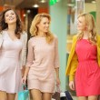 Group of female friends in the shopping mall — Stock Photo