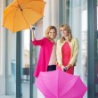 Cheerful ladies posing with the umbrellas — Stock Photo
