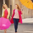 Two attractive girlfreinds with the umbrellas — Stock Photo