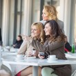 Smart ladies looking at something interesting — Stockfoto