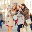 Three girlfriends indicating something interesting — Stock Photo