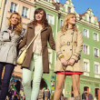 Group of friends in the crowdy downtown — Stock Photo