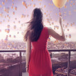 Young woman staring at thousands of the balloons — Stock Photo #43269857