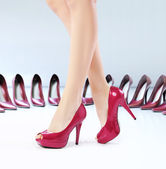 Pretty feets on the high-heel shoes — Stock Photo