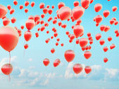Hundreds of the red flying balloons — Stock Photo