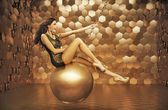 Sensual woman playing on the big ball — Stock Photo