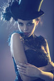 Portrait of na attractive young female model with the top hat — Foto Stock