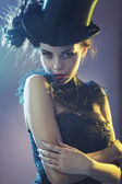 Portrait of the alluring young female model with the top hat — Stock Photo