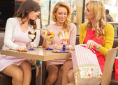 Attractive ladies in the shopping mall — Stock Photo