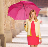 Smart woman waling with umbrella — Foto de Stock