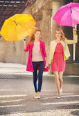 Two girlfriends walking during windy day — Stock Photo