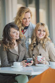 Three best friends in the coffee shop — Stock Photo